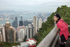 Woman looks at the prospect of Hong Kong. Tourist looks at the prospect of Hong Kong Royalty Free Stock Photography