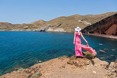 Woman  looks at the red beach in Santorini, Greece Stock Images