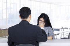 Woman looks rejected in job interview Stock Images