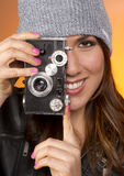 Woman Looks Right at the Camera taking a picture too Royalty Free Stock Photo