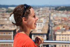 Woman looks at Rome from Altar of Fatherland. Beautiful young woman looks at Rome from Altar of Fatherland in Rome, Italy Royalty Free Stock Photo