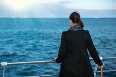 Woman looks at the sea Royalty Free Stock Image