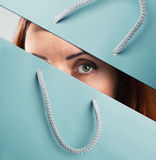 Woman looks through shopping bag Royalty Free Stock Image