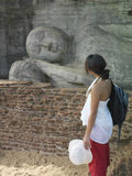 Woman Looks At Sleeping Buddha Statue Stock Photos