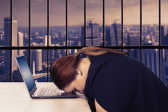 Woman looks tired in the office Royalty Free Stock Image