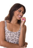 Woman looks to the side as she brushes her teeth. Happy lady brushing her teeth Stock Image