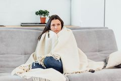 Woman looks TV on the couch. Beautiful woman watching TV fell asleep. royalty free stock images