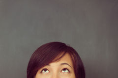Woman looks up, copyspace Stock Images