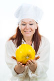 The woman looks at a yellow melon Royalty Free Stock Images