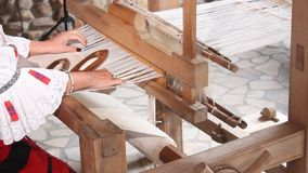 Woman at loom stock video