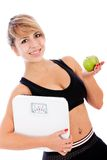 Woman loosing weight Royalty Free Stock Images