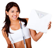Woman loosing weight Royalty Free Stock Photos
