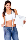 Woman loosing weight Stock Images