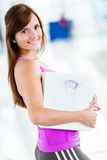 Woman loosing weight at the gym Stock Image