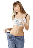 Woman loosing weight and showing a thumb up sign Stock Photography