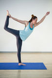Woman in lord of the dance yoga pose Stock Photography