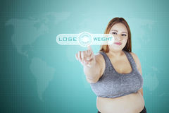 Woman with lose weight text on screen Royalty Free Stock Photos
