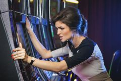 Woman is losing during slot machines game stock photos