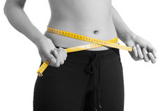 Woman losing weight Royalty Free Stock Photos
