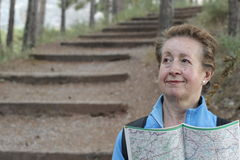 Woman lost hiking, confused looking at map Royalty Free Stock Images