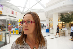 Woman lost in shopping mall Royalty Free Stock Images