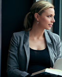 Woman lost in thought Stock Images