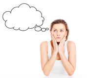 Woman lost in thoughts. A picture of a young woman lost in thoughts over white background Royalty Free Stock Image