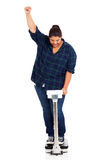 Woman lost weight. Happy overweight woman lost weight on scale Royalty Free Stock Photography