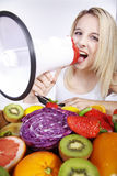 Woman with a lot of fruits and megaphone Royalty Free Stock Photo
