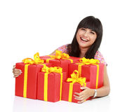 Woman with a lot of gift boxs Stock Photography