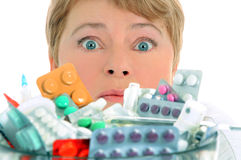 Woman with a lot of medicine to take Stock Image