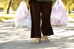 Woman with a lot of packs. Summer shopping stock photo