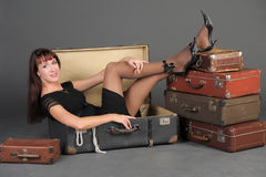 Woman and a lot of suitcases Royalty Free Stock Photography