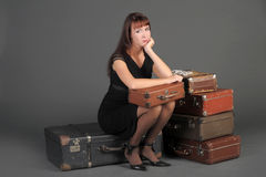 Woman and a lot of suitcases Stock Images