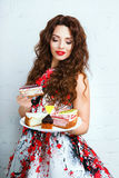 Woman with a lot of various cake pieces. Girl in the dress holding cheesecake Stock Photos