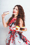 Woman with a lot of various cake pieces. Girl in the dress holding cheesecake Royalty Free Stock Photos