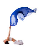 Woman in lotos yoga pose with blue flying fabric Royalty Free Stock Photos
