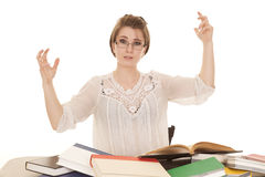 Woman lots of books hands in the air Stock Images