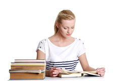 Woman with lots of books studying for exams. Royalty Free Stock Photo