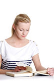 Woman with lots of books studying for exams. Royalty Free Stock Images