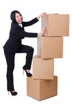 Woman with lots of boxes. On white Royalty Free Stock Photo