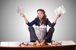 Woman with lots of discarded paper Stock Images