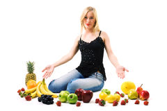 Woman and lots of fruits Royalty Free Stock Photos
