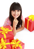 Woman with a lots of presents Royalty Free Stock Images