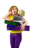 Woman with lots of presents Royalty Free Stock Image