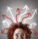 Woman with lots of s coming out of her head Royalty Free Stock Photos