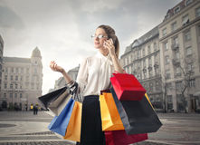 Woman with lots of shopping bags Stock Image