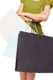 A woman with lots of shopping bags. Isolated on white background Royalty Free Stock Images