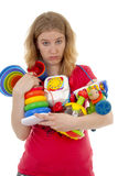 Woman with lots of toys Royalty Free Stock Image