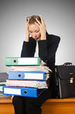 Woman with lots of work Royalty Free Stock Images